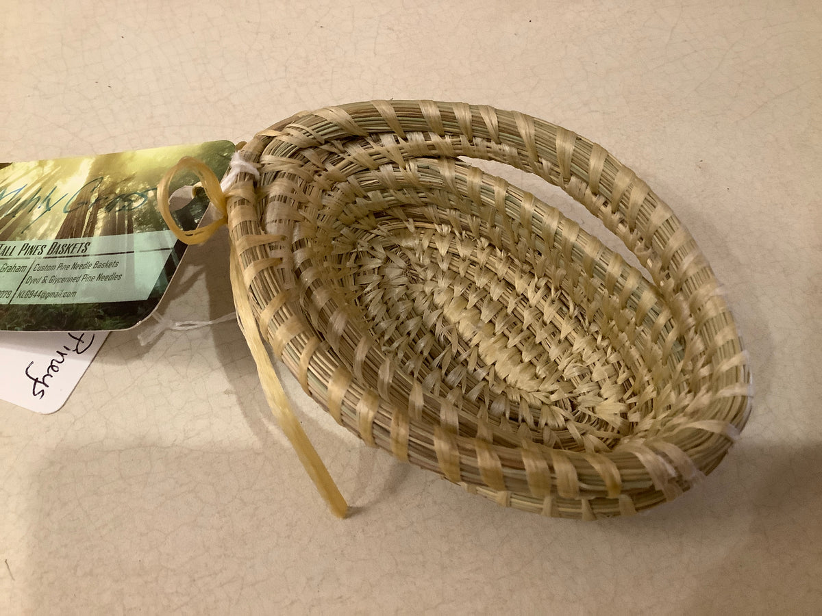 Small natural pine needle basket
