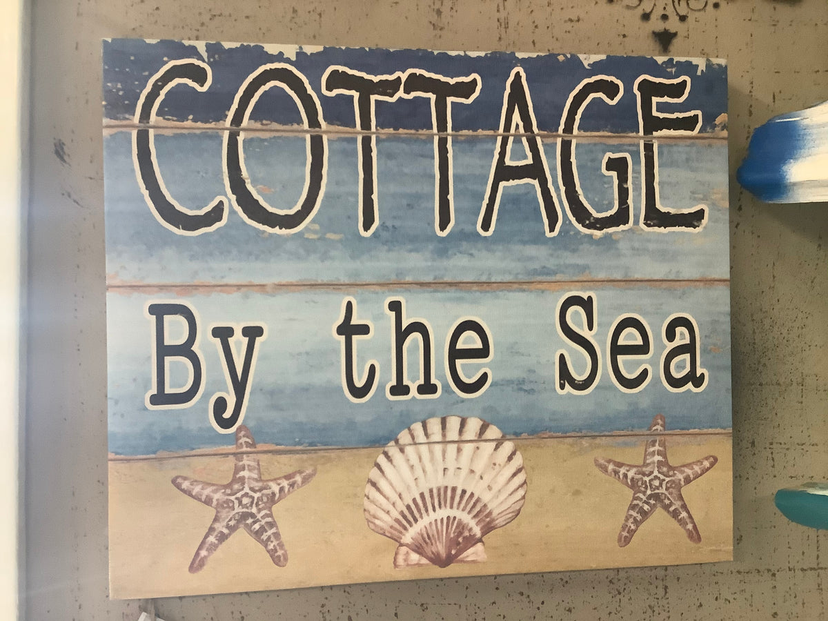 Cottage by the sea sign