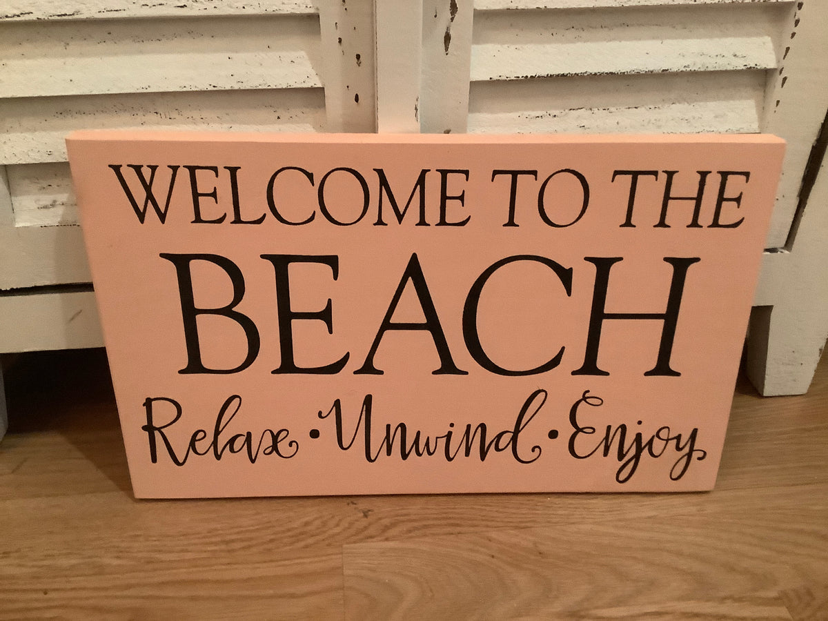 Relax unwind enjoy beach sign