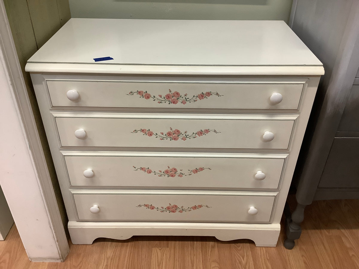 White dresser with flowers