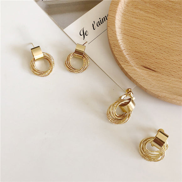 Ins cold wind metal circle geometric earrings female Korean ring winding earrings net red tide earrings F122