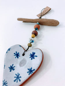 Blue and white pottery with driftwood heart hanger handmade by Shoreline Ceramics