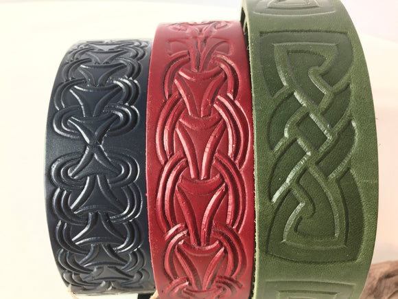 Handmade wide leather belts in red, blue or green, impressed with Celtic-themed patten