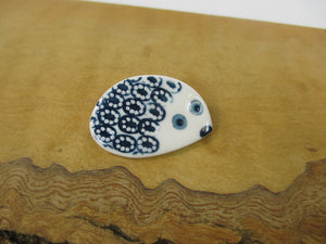 Porcelain blue hedgehog brooch by Katy Mai