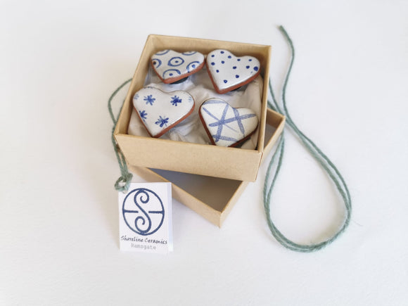 Box of four pottery heart magnets by Shoreline Ceramics