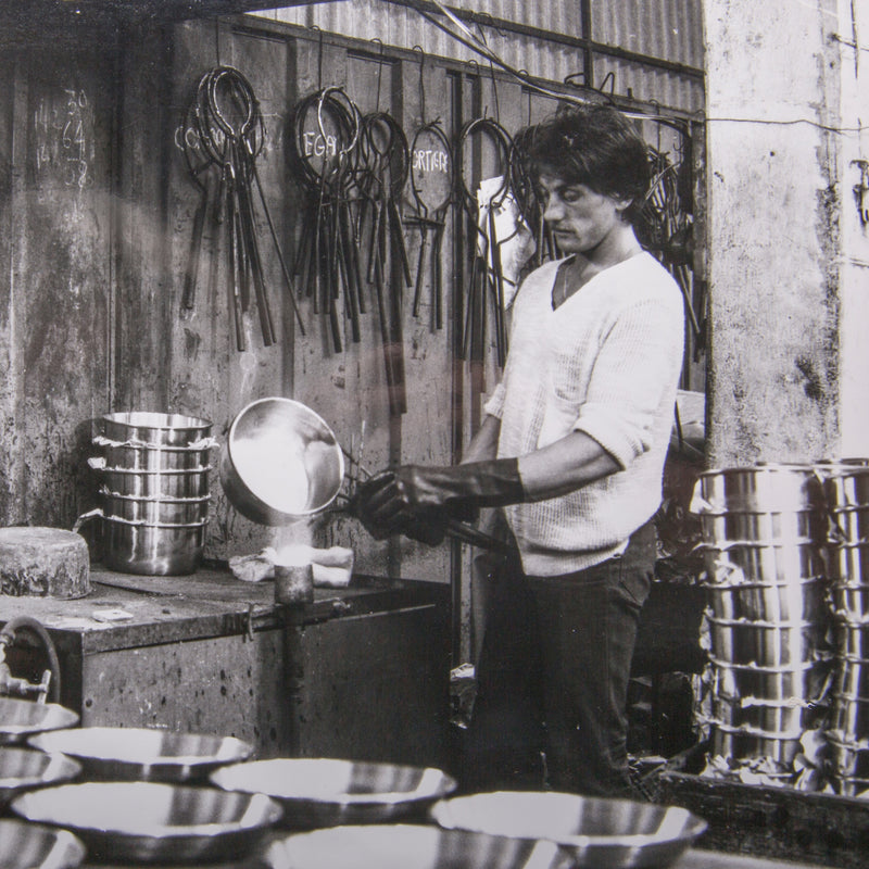 black and white image of Ruffoni cookware being made long ago