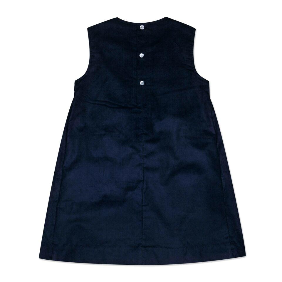 PINAFORE DRESS IN NAVY CORD WITH ROSE SMOCKING