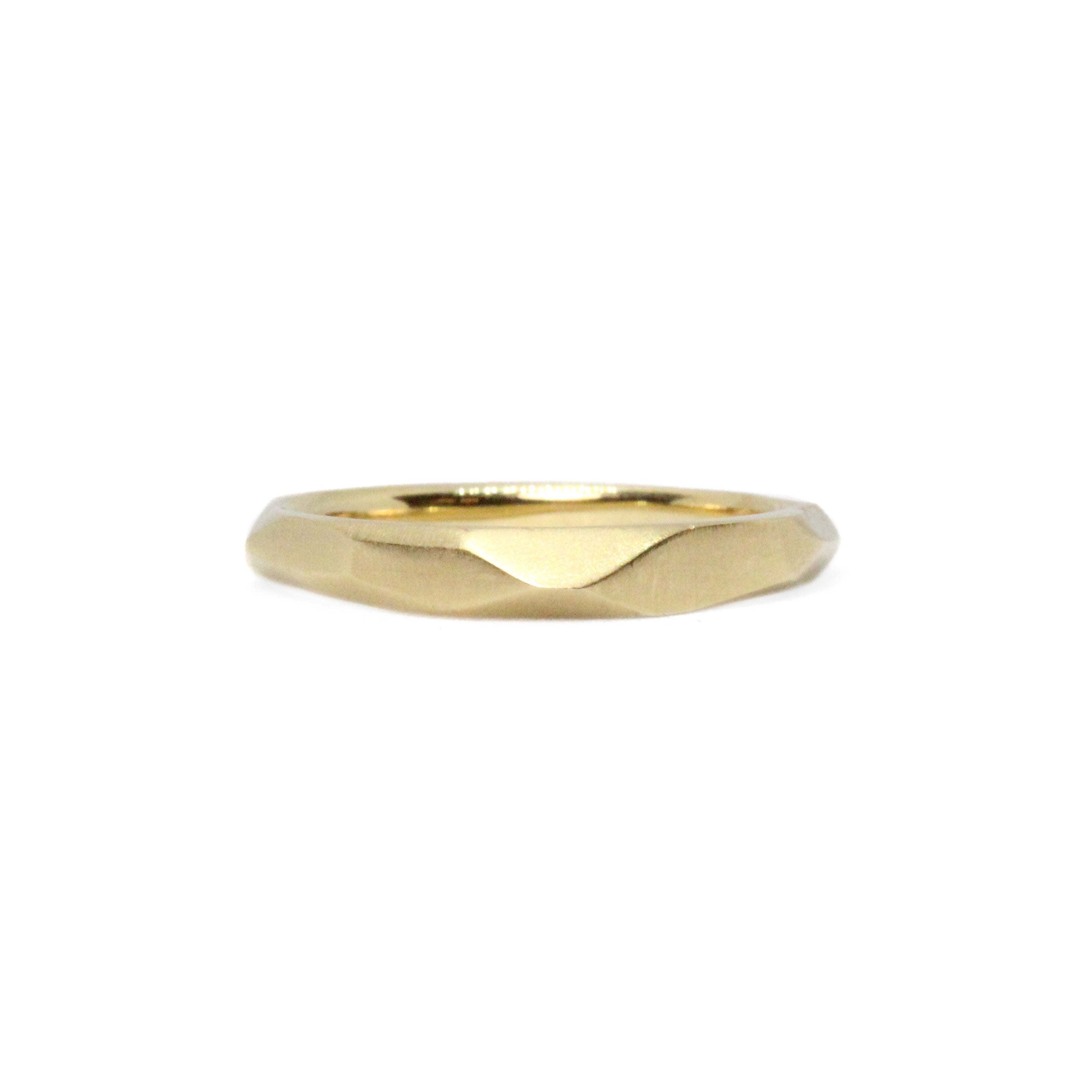yellow gold faceted band ring