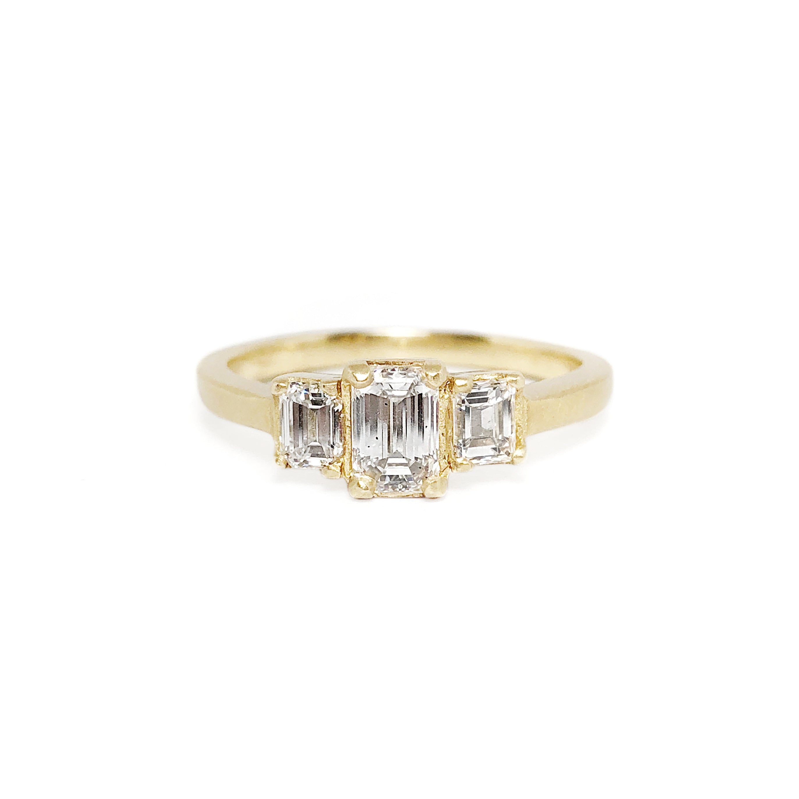 yellow gold triple emerald cut diamond ring