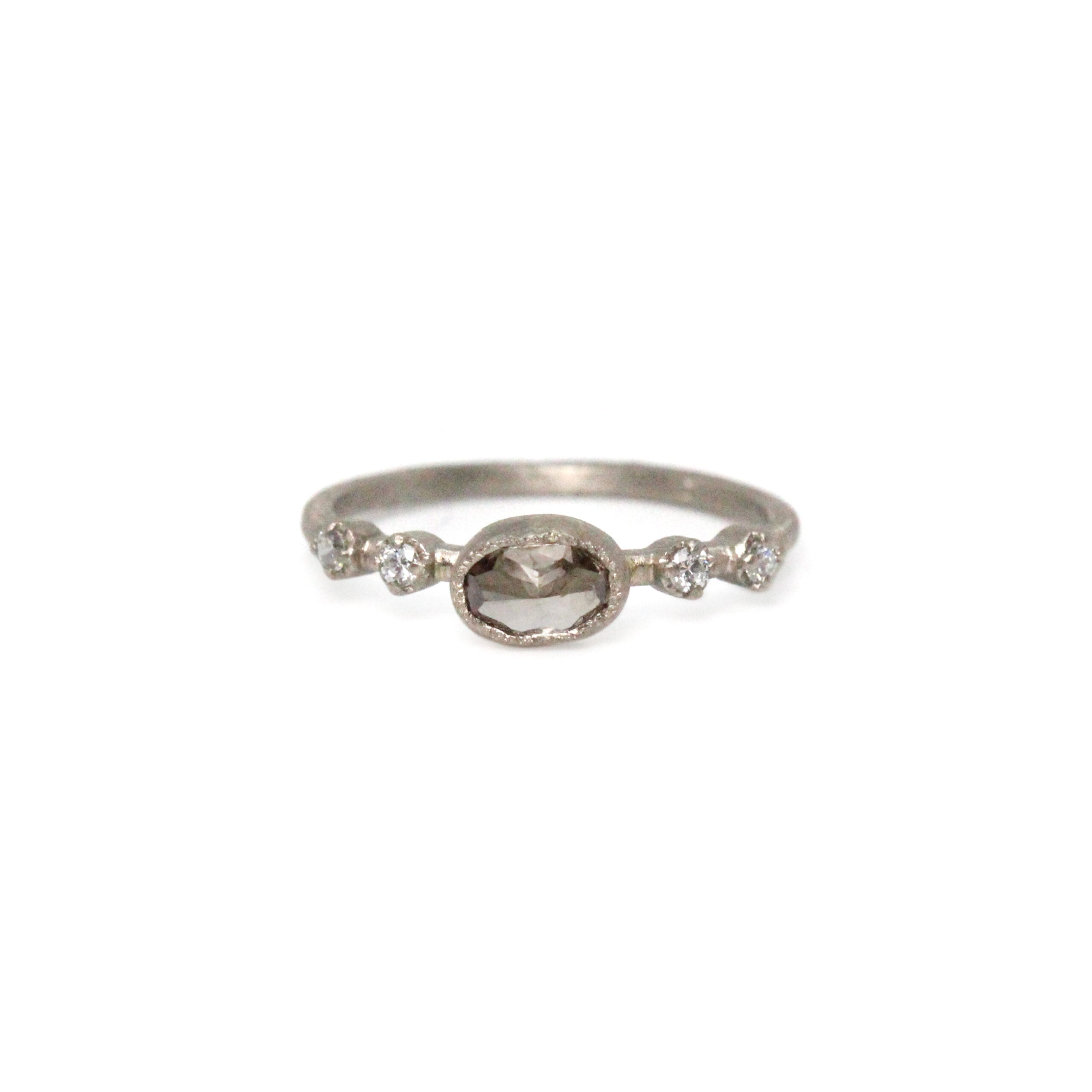 white gold and oval brown diamond ring