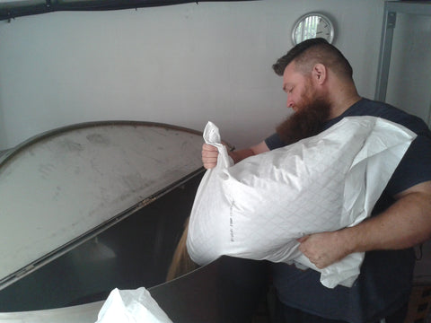Head Brewer Phill Blanchard loading the hopper with grain for our next brew