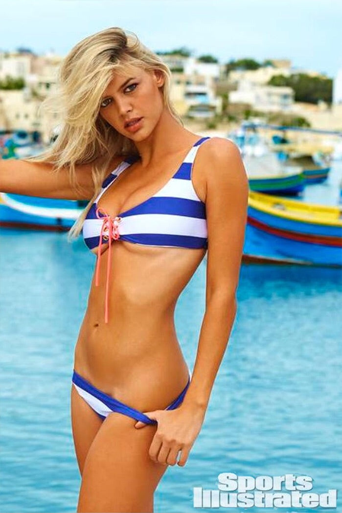 As seen in Sports Illustrated Nautical Blue Stripe Swimsuit - Coral Ties