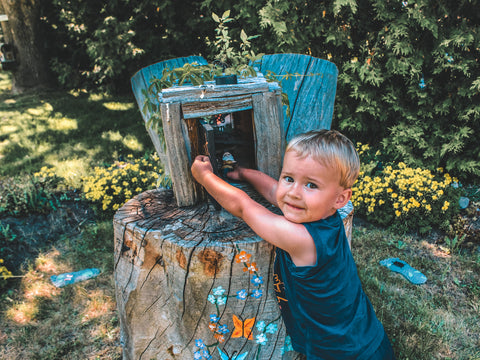 Child exploring the fairy garden at Seven Forty Six Shop