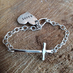 cross bracelet with heart tag