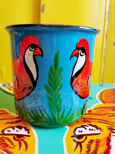 Handpainted in Pakistani by the artisans that paint the fabulously flamboyant trucks! These mugs are painted with heavy duty enamel paints onto deadstock enamelware. Suitable for light cool water washing only. Due to there handmade production, designs may vary and also have imperfections.  Dimensions 9.5cm high, 10 cm diameter