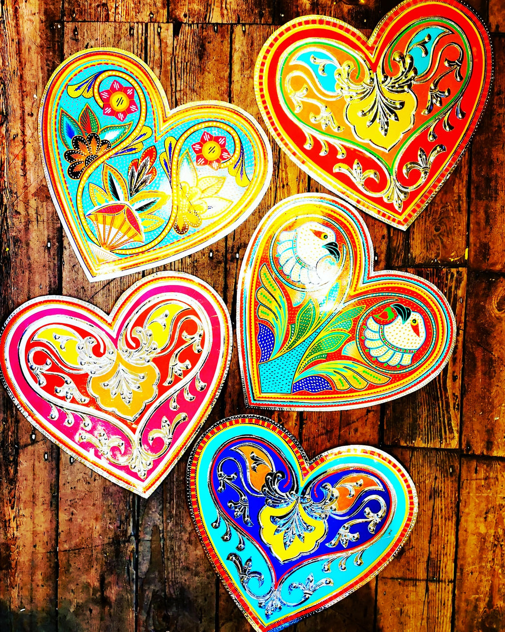 Hand made in Pakistan by the artisans that decorate the fabulously flamboyant trucks, these beautifully crafted metal plaques are decorated with hand cut reflective vinyl stickers. All so you can add a bit of folk art love to your home!  40cm x 38cm
