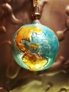 Traditional hand blown, painted glass decoration from Lauscha Germany.  This German mouth blown and lovingly hand painted glass globe decoration will bring some Christmas splendor to your house and tree.  Hand-blown/painted glass decoration  Dimensions 6cm x 6cm