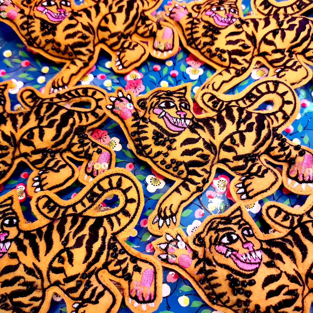 Embroidered tiger brooch
