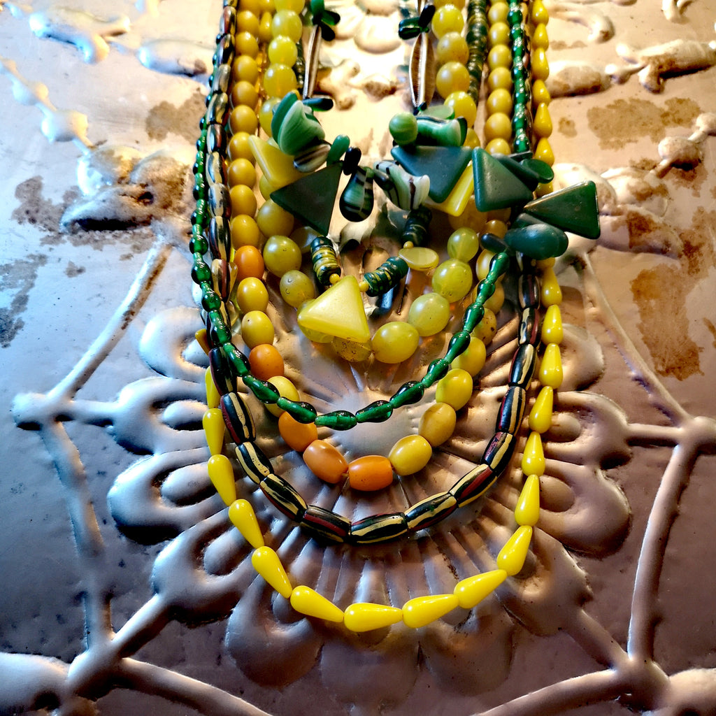 Green and yellow collection of antique and vintage trade beada