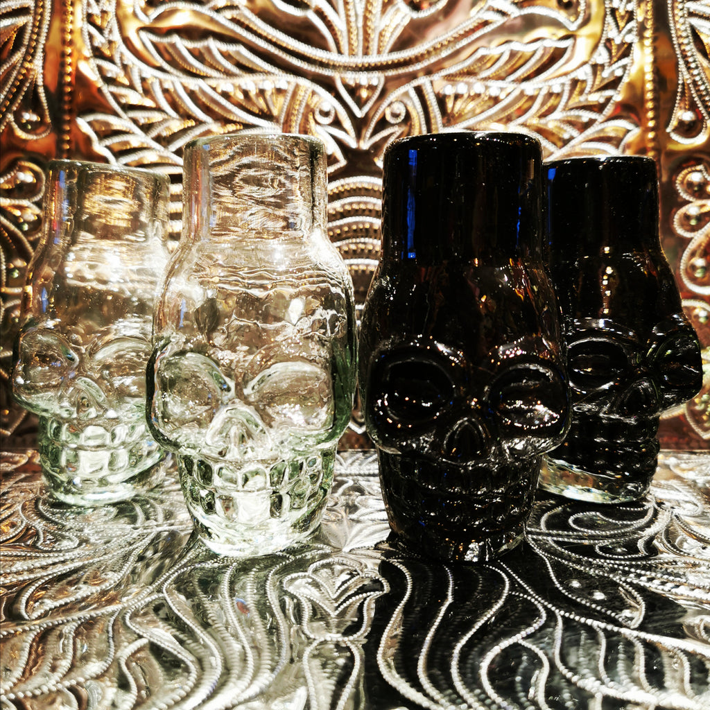Dastardly Day of the Dead hand blown shot glasses in black or clear recycled glass. Handmade in Mexico these are a fabulous gift and even make super cute posy holders!!  Made in Mexico   Recycled glass  Dimensions vary as these are handmade but around 9cm x 5cm x 5cm