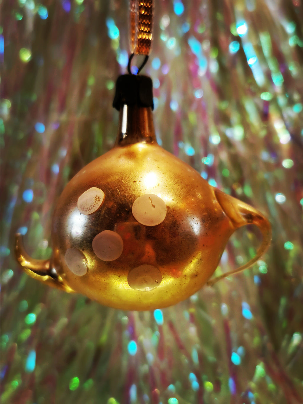 Gorgeous vintage mercury and painted glass stylised pastel gold spotty teapot christmas ornament from the former Soviet Union. Beautifully hand made and decorated. This dates from the 1960s Once you start collecting these it is difficult to stop!!  Made of glass with a steel top and is all original, to be handled and cleaned gently.  Dimensions 6cm high