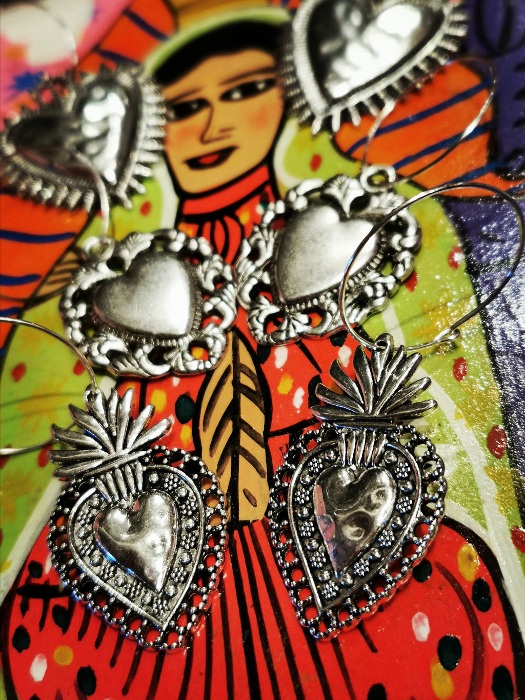 Gorgeous bit of love and fun with these sacred heart costume hoops. Designs taken from Mexican milagros, (miracles) given to the church in hope of a bit of help from the Saints in matters of love...  Silver plated base metal hearts Approx 4cm long  Silver plated stainless Steel hoops 2.5cm diameter