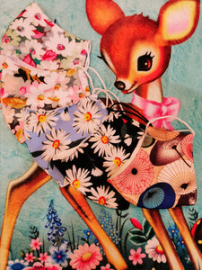 Super retro style gorgeous soft cotton face masks in cutest, kitsch floral and parasol prints, cut from end of line fabrics, great to use fabric that would have otherwise gone to waste. This design is super comfortable, three layer, and you can also add filters.  Fully machine washable.   One Size, cotton and elastic.