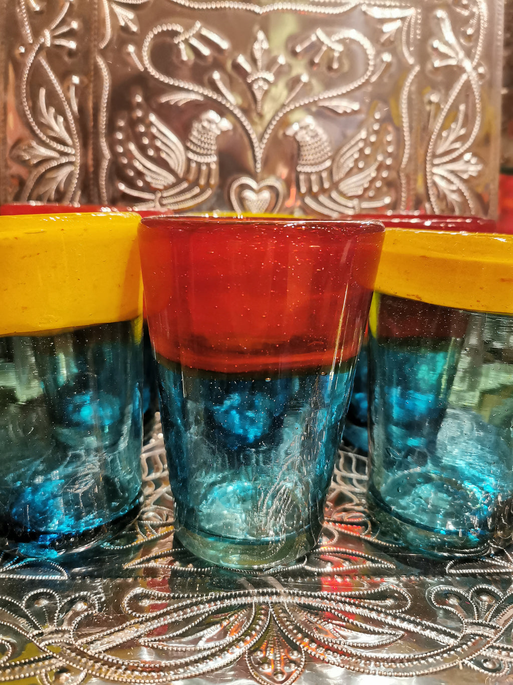 Beautifully handmade in Mexico from recycled glass, these colourful tumblers are super sturdy and gorgeous too!!  Designs vary due to their handmade nature.   Dimensions 8cm x 8cm x 12cm high.