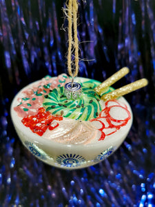 This poke bowl bauble is a foodies delight!!. A handpainted and glittered American heirloom bauble to be treasured.   10cm x 8cm x 5cm  Glass and glitter