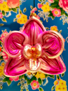 Fabulous floral tropical orchid in the pinkest pink! A great gift for a plant lover, this one can be hung on a pot plant all year round!   Handpainted and glittered  10cm x 10cm x 6cm