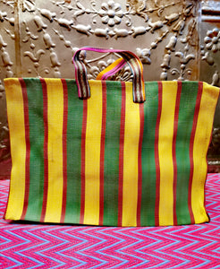Super bold and graphic in punchy colour combos, these striped shoppers are super useful for storing items around the house as well as helping out at the shops!  These area very handy size when out and about but also nice and square to line up on shelves as storage!  These are made of woven nylon and all have zips.   Dimensions 39cm x 34cm x22cm