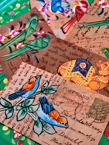 This form of painting in India is typically undertaken by the apprentices learning to paint miniatures. They often used recycled documents, letters and in this case postcards. All are original pieces.