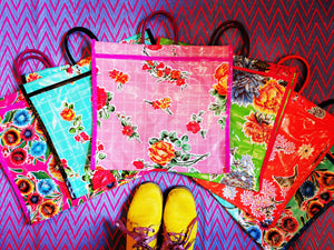 Kitsch, strong and gorgeous too!, these shoppers are a staple of Mexican Market life! A different colour for every outfit and washable, so fab for the recycling and all those wild swimmers too!   40cm x 35cm x 9cm  Plastic oilcloth and handles, metal rivets
