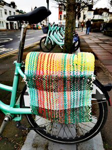 Handwoven in Iran, these bike panniers are just gorgeous and all are unique.Strong and washable, these are also fab on the sofa for keeping your books, magazines and remote/games chuff in too!!  95cm x 42cm  Pocket depth 33cm  Recycled /excess Polycotton and Jersey string  Washable on 30 degrees