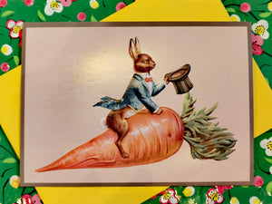 Slightly crazy vintage German illustration of an Easter bunny riding a carrot, remade as a postcard, and embossed to give a 3D quality to the dapper rabbit and his ride!!  6 inch by 4 inch, classic postcard size, comes with envelope.
