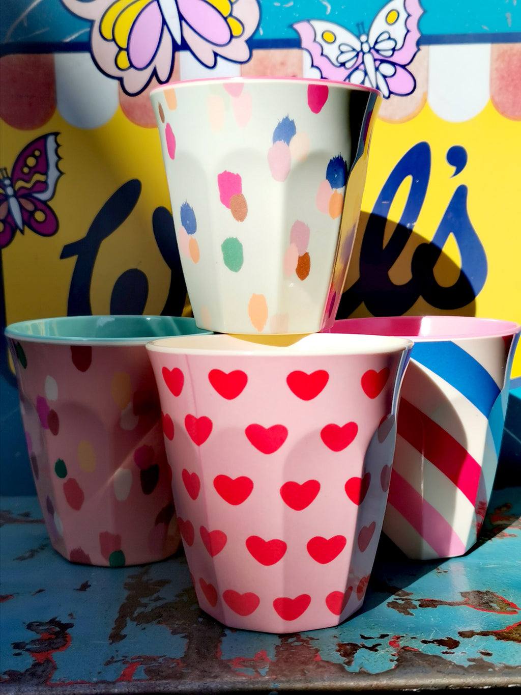 Fab patterns in these classic melamine beakers, stack them up and enjoy adding a bit more colour to your kitchen!  Durable and safe (BPA free) , these are great for kids, camping, picnics and the joy of colour!  Hot and cold drinks, ice cream too!!   Dishwasher safe, but do not use in the microwave.   9cm high, top diameter 8.5cm