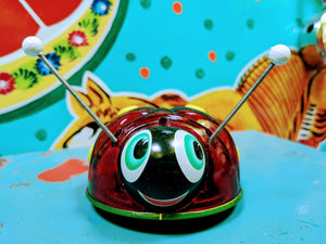 Lady bug tin toy  This ladybird flashes and glows with excitement as you roll her along!