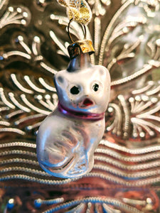 Traditional hand blown, painted glass decoration from Lauscha Germany.  This German mouth blown and lovingly hand painted Tiny cat decoration will bring some Christmas splendor to your house and tree.  Size 7 x 3 cm  Fragile, handle with care