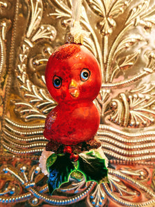 Kitsch Robin christmas decoration. This fantastic Kitsch Robin ornament will bring some christmas glitz to your Christmas tree or festive holiday display.  Hand-painted glass decoration   Size 13 cm tall Fragile, handle with care