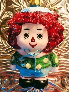 Kitsch retro doll christmas bauble. This hand blown fantastic retro doll ornament is a great addition to your Christmas tree or festive holiday display.  Hand-painted glass decoration   Size 10 x 8 x 5 cm  Fragile, handle with care