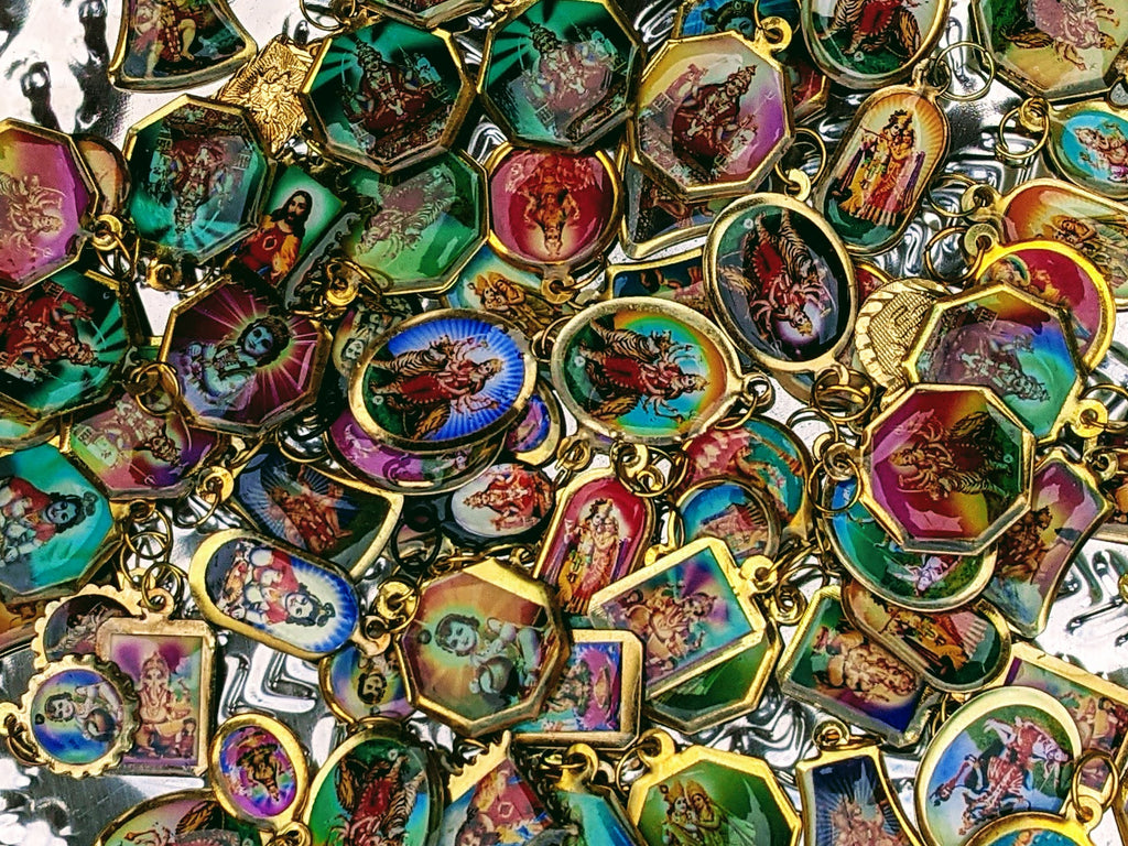 Hindu god pendants  Selection of 10 random pendants  Base metal brass or copper.  approx 1 x 1 cm