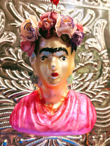 Frida Kahlo the Mexican painter known for her many portraits, self-portraits, and works inspired by the nature and artifacts of Mexico.  Gloriously painted and super kitsch Frida made from glass!  10 x 8 cm