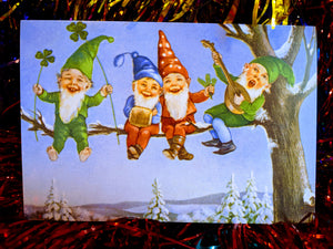 Cheeky christmas gnomes singing carols   We think these fabulous cards count as a present too, and look great framed up.  single card  Dimensions 12 x 18 cm
