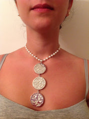 Solid silver necklace with mother pearl behind the  three galligraphic element and pearl for the chain