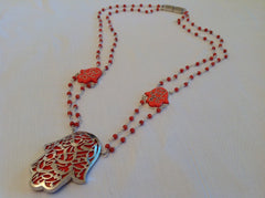 very original Pendant in solid silver and coral stones