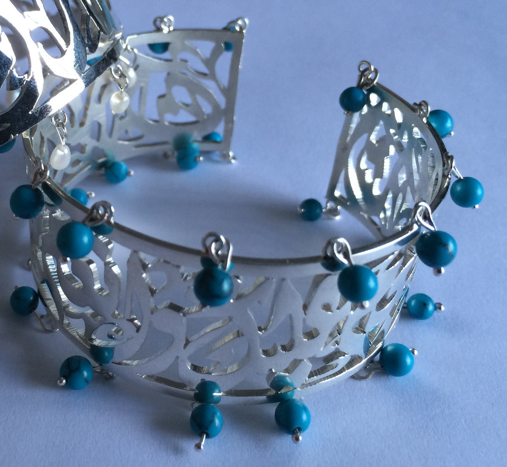 solid silver bracelet with turquoise stones