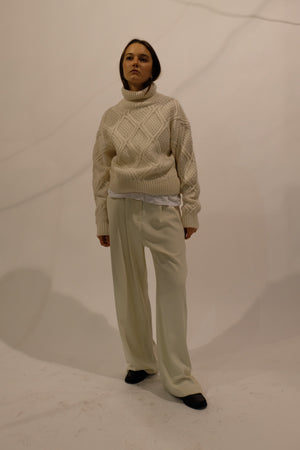 CABLE KNIT TURTLENECK SWEATER IN CREAM