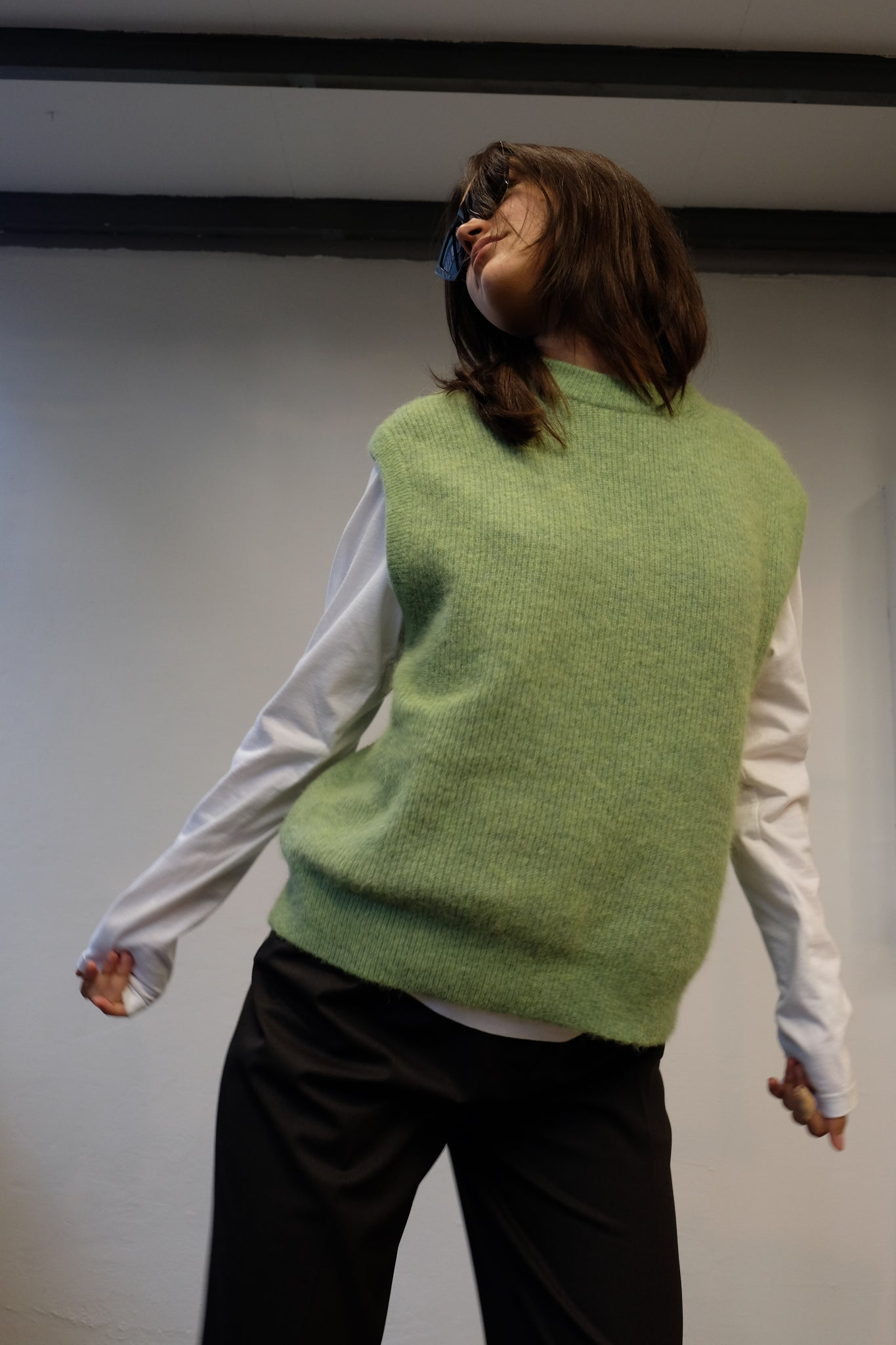 KNITTED VEST IN GREEN