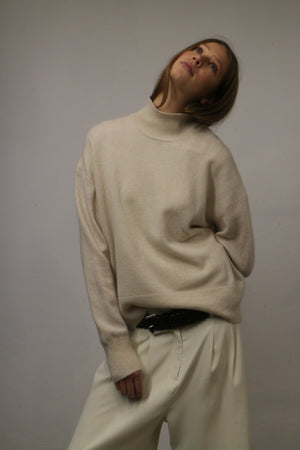 WOOL KNITTED TURTLENECK SWEATER IN IVORY WHITE