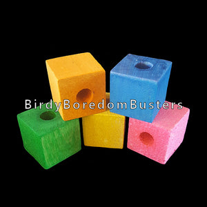 "Brightly colored 1"" hardwood blocks with a 3/8"" center hole. Use for intermediate to medium sized toys.  Package contains 6 blocks."